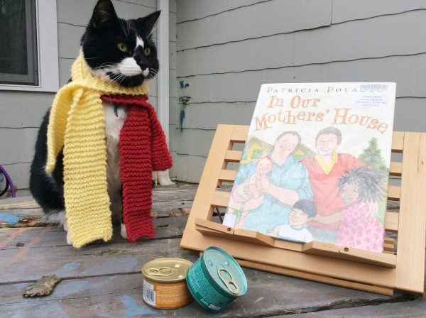 "TeddyBoy Sinclair with book entitled ""In Our Mother's House"""